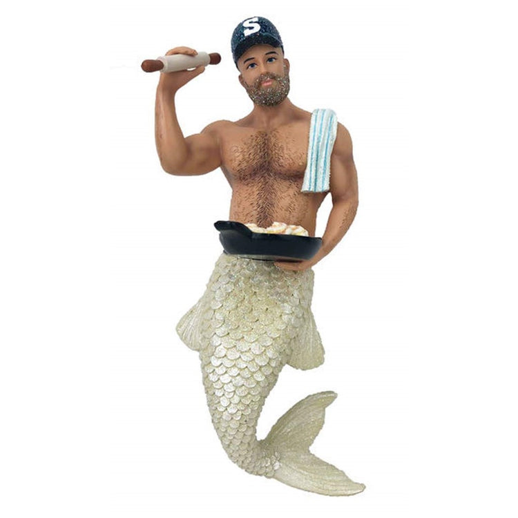 Mermaid figurine ornament.  Dressed as a baker holding a rolling pin and pack of sticky buns.  Hand towel over his shoulder.