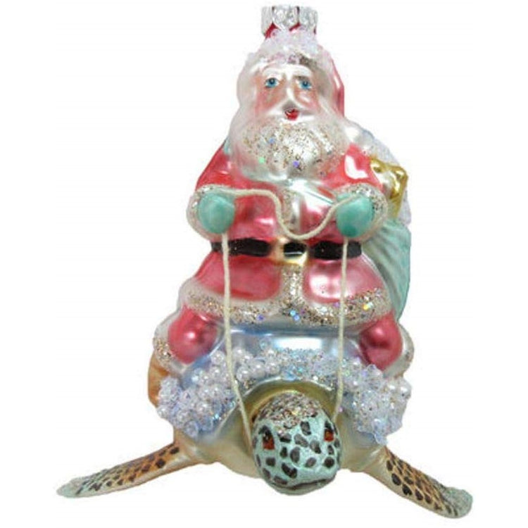 Figurine hanging ornament.  Santa clause is riding a sea turtle, Pastel shades of pink and blue. Bead embellishements.