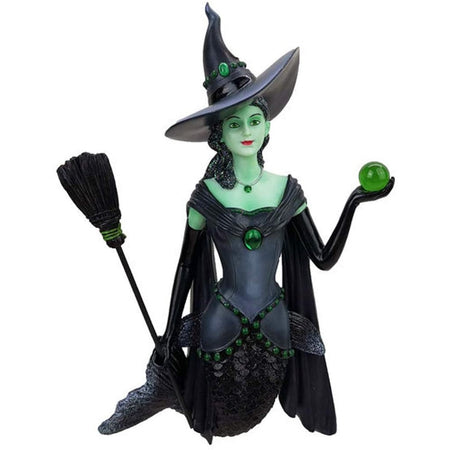 Mermaid shaped figurine ornament.  Green body, dressed in black as a witch with hat broom and carrying a green ball.