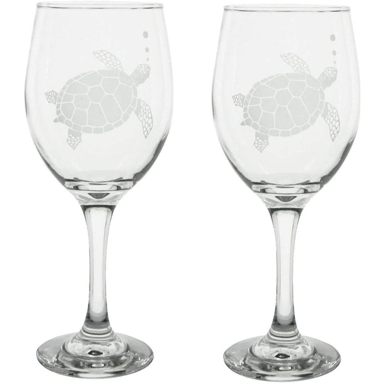 Clear wine glasses with a sea turtle etched in each glass.