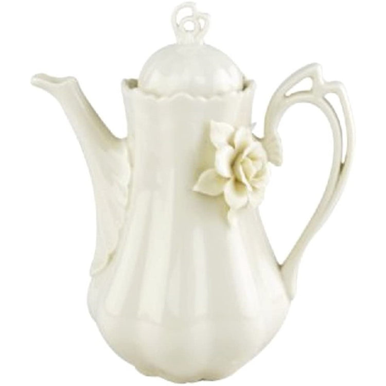 White elegant teapot with a glass white rose.