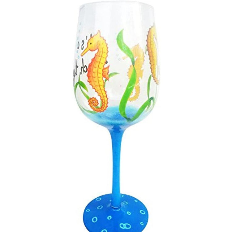 blue stem glass with seahorses on it & 'it's a beach thing'.
