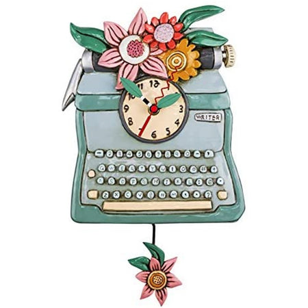 typewriter shaped clock with a flower pendulum.