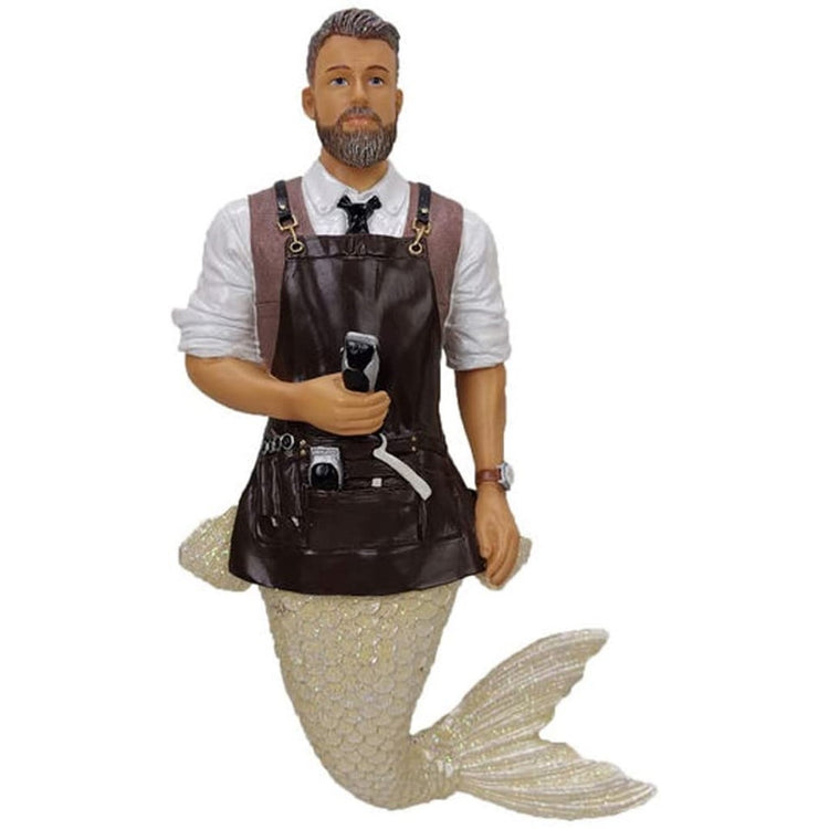 Merman shaped figurine ornament.  Dressed as a barber with apron, tools and carrying a razon.