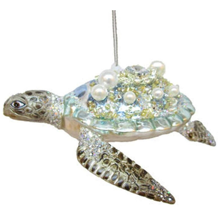 Light blue and green sea turtle embellished with sparkles and pearls.