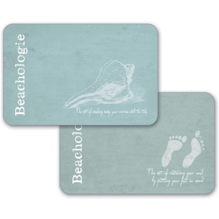 "2 light aqua placemats with shells and the word ""beachologie"""