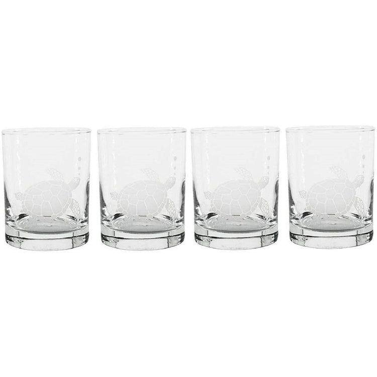 4 clear glasses with a sea turtle etched in see-through white