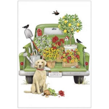 green truck with flowers, plants & birdhouses & a lab