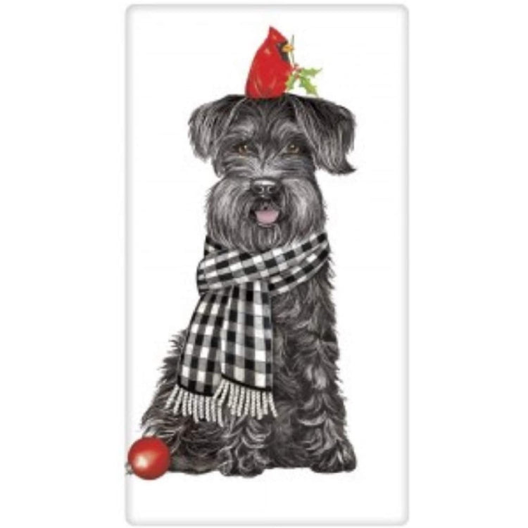 black schnauzer dog in black checked scarf with a cardinal on his head.
