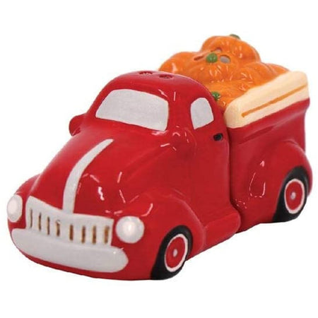 red truck with orange pumpkins in the bed