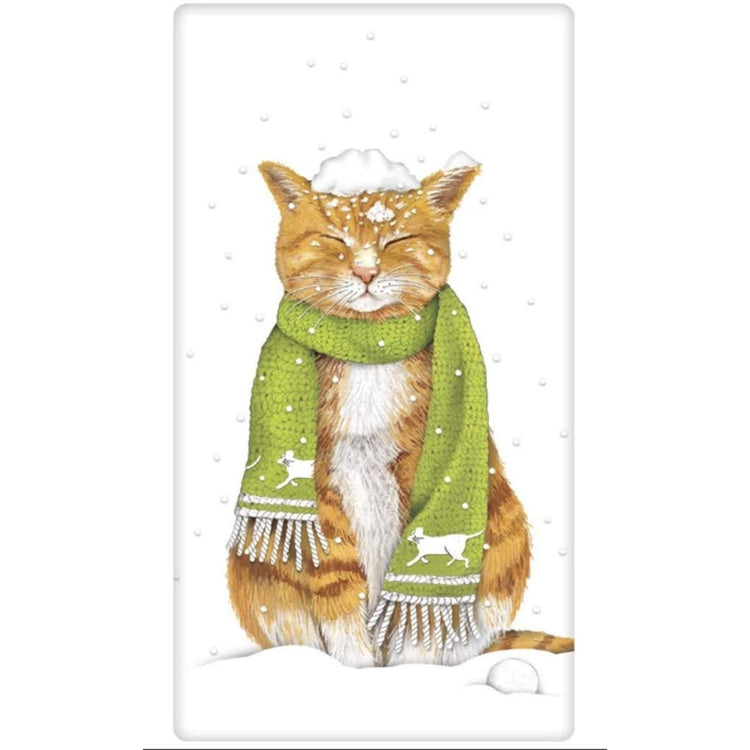 White flour sack kitchen towel imprinted with cat in the snow wearing a green knit scarf.