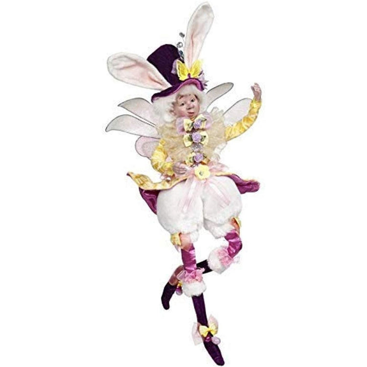 Male fairy figure with wings wearing yellow and purple with bunny ears.