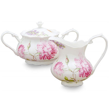 Covered sugar bowl and matching creamer. White with pink floral print.