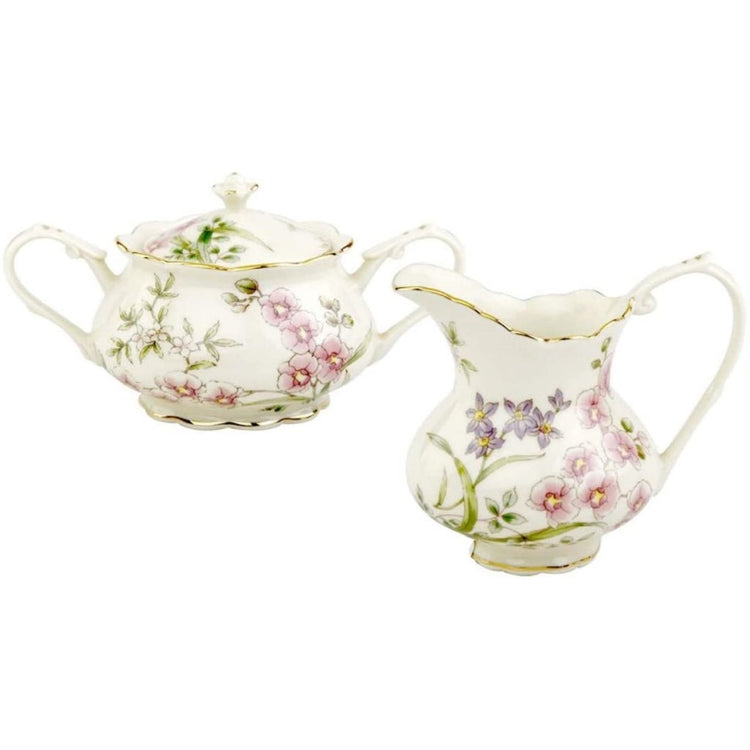porcelain cream and sugar set. Set is white with pink and purple floral design.