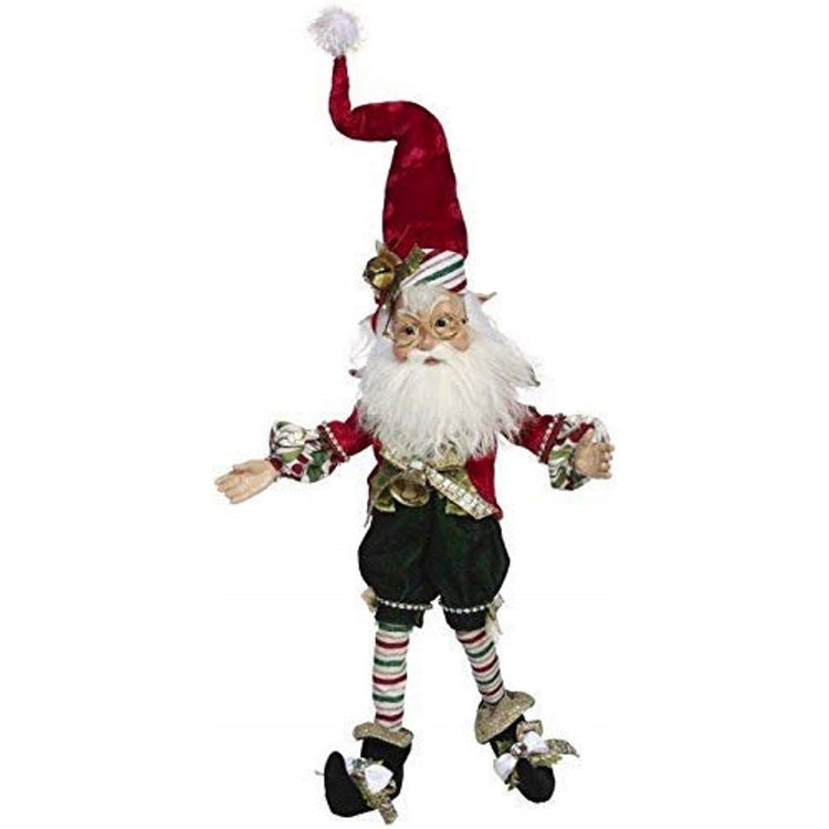 Elf figure wearing red, white and green candy cane stripes and red hat.