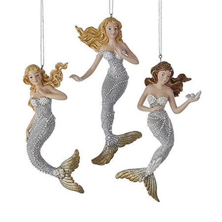 3 mermaid ornaments. 2 blonde mermaids, one has brown hair. All of the mermaids are silver & gold with pearls.