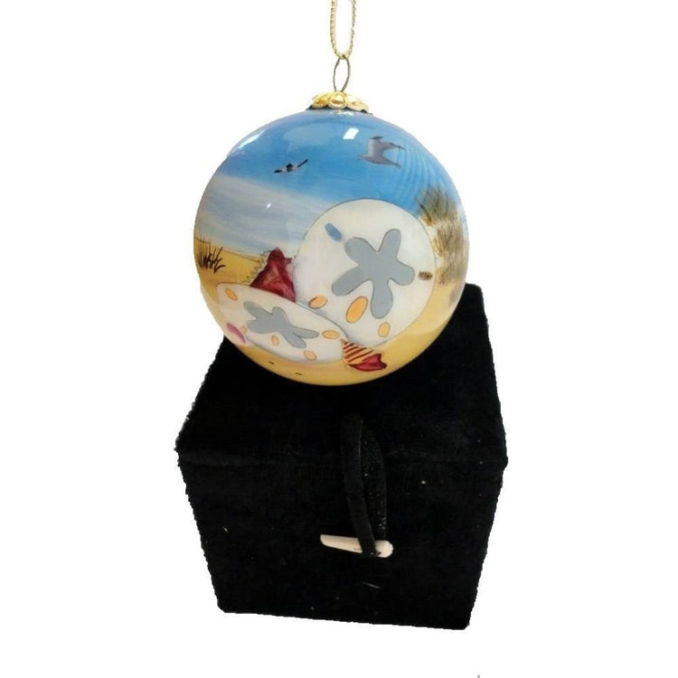 Ball ornament painted with blue sky and white sand dollars, black  gift box
