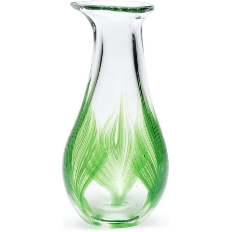 Clear vase with a 3 green palm design on it.