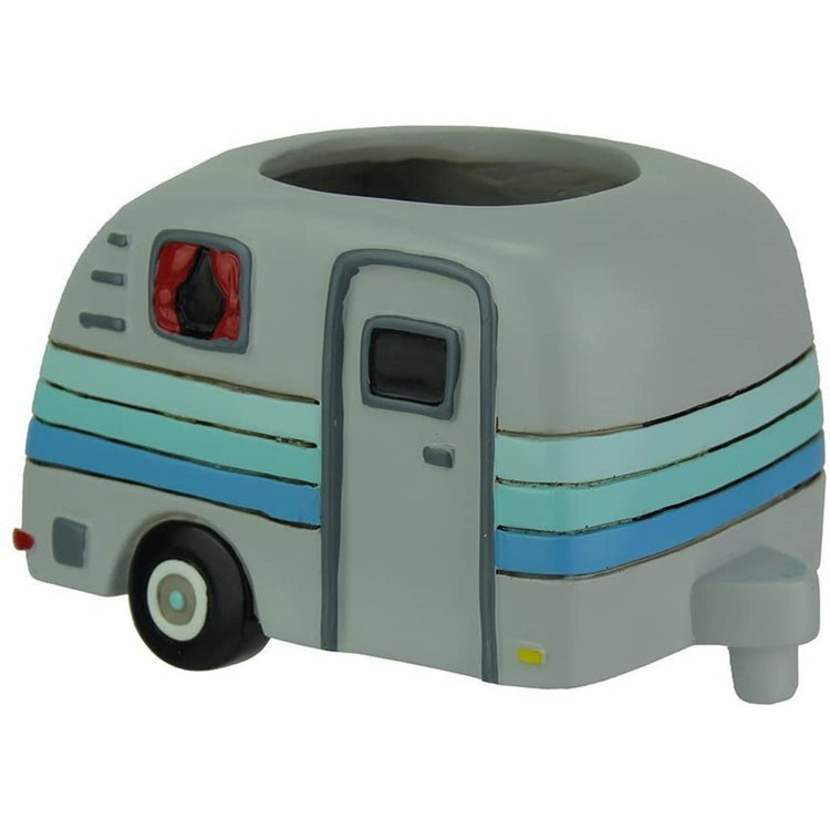 Gray camper trailer design small planter. Camper has blue stripes with a round hole for a plant.