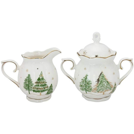 white cream & sugar set with gold & green fir tree design.
