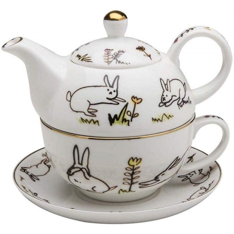 White tea for one on saucer.  Gold bunny print accent.