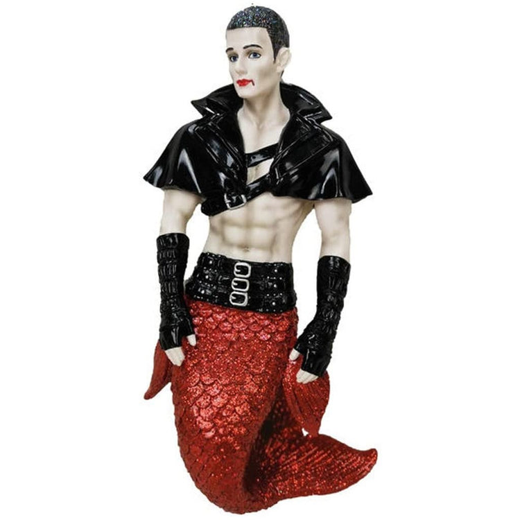 Merman shaped figurine ornament.  Dressed with a black cape and gloves.  White body with red lipstick and blood dripping from mouth.