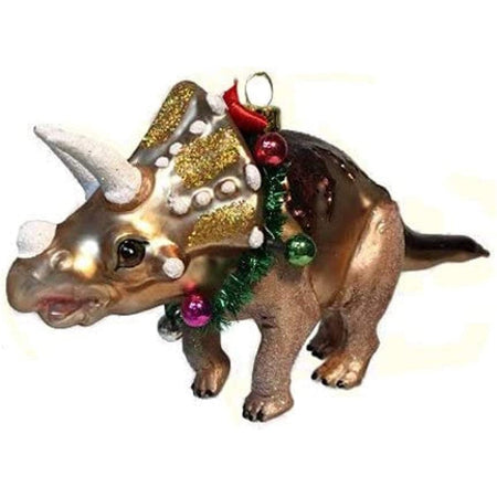 Brown 3 horn dinosaur with gold glitter embellishment & a wreath around its neck with ornaments.