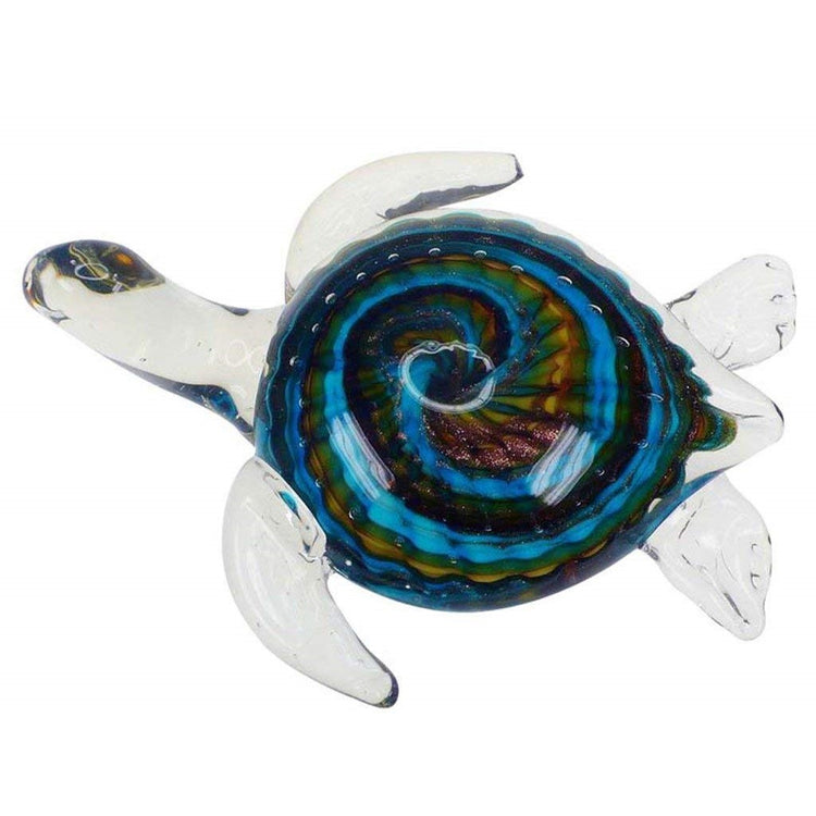 Clear sea turtle figure with swirls of blue green and gold under.