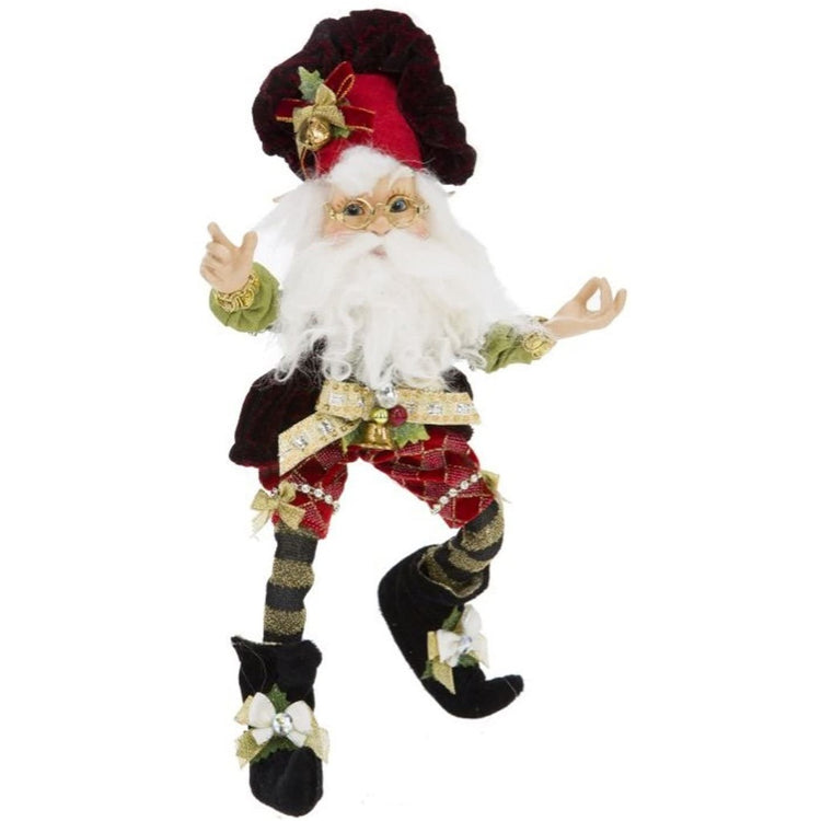 Bearded elf with christmas outfit and red bakers hat on. He has bells on his hat & clothes.