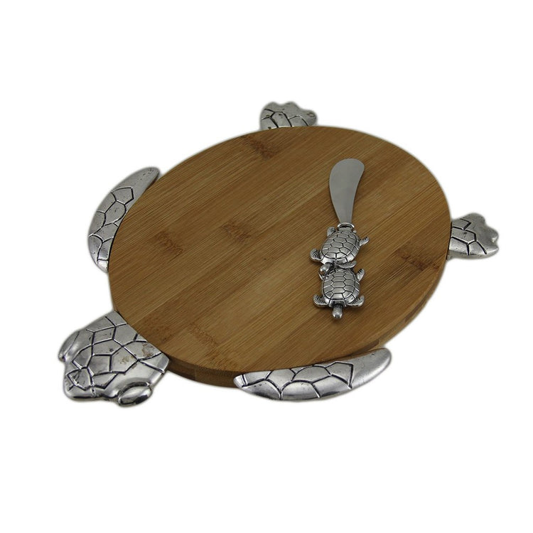 Oval Shaped wood cutting board with attached metal icons to create a sea turtle shape.  Double sea turtle spreader.
