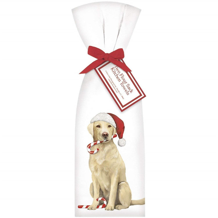 2 white towels tied with red ribbon. Towel shows a yellow lab in a Santa hat with a candy cane in his mouth.