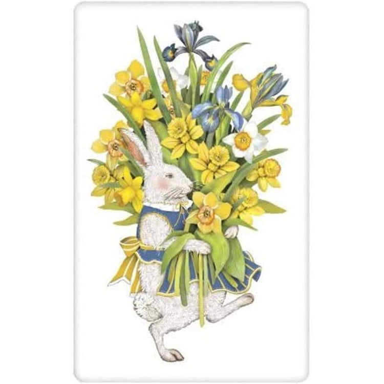 white towel showing a white rabbit in blue apron, blue white and yellow flowers.