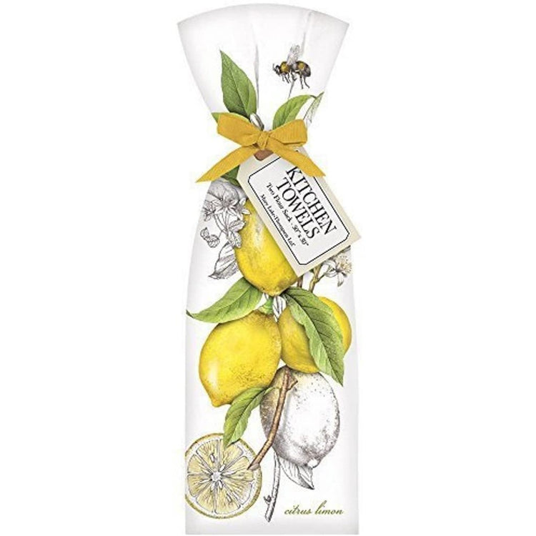 White flour sack kitchen towel accented with bunch of yellow lemons. Tied with yellow ribbon.