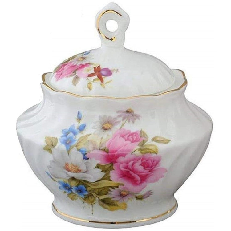 White sugar bowl with a pink rose & other flowers.