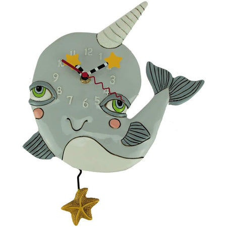 Grey narwhal with a white horn, green eyes, & yellow starfish.