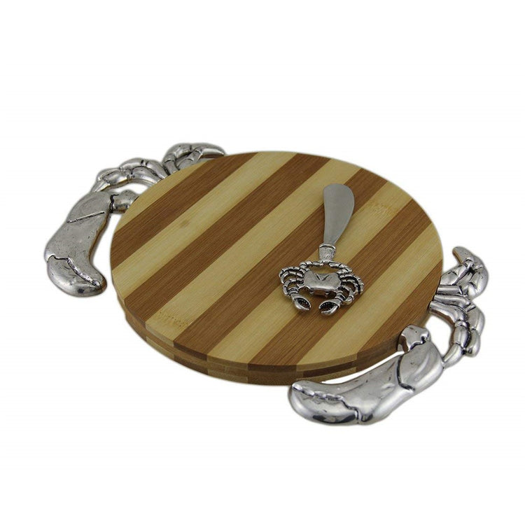 Round wood center cutting board with metal adornments to look like a crab.  Metal crab designed spreader.