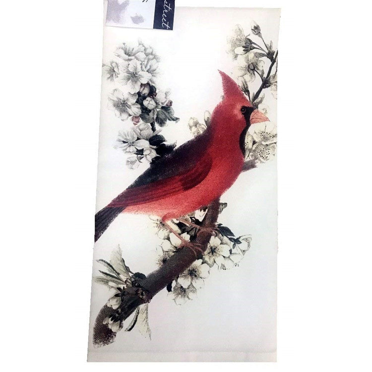 White kitchen towel with red cardinal on cherry blossom branch.