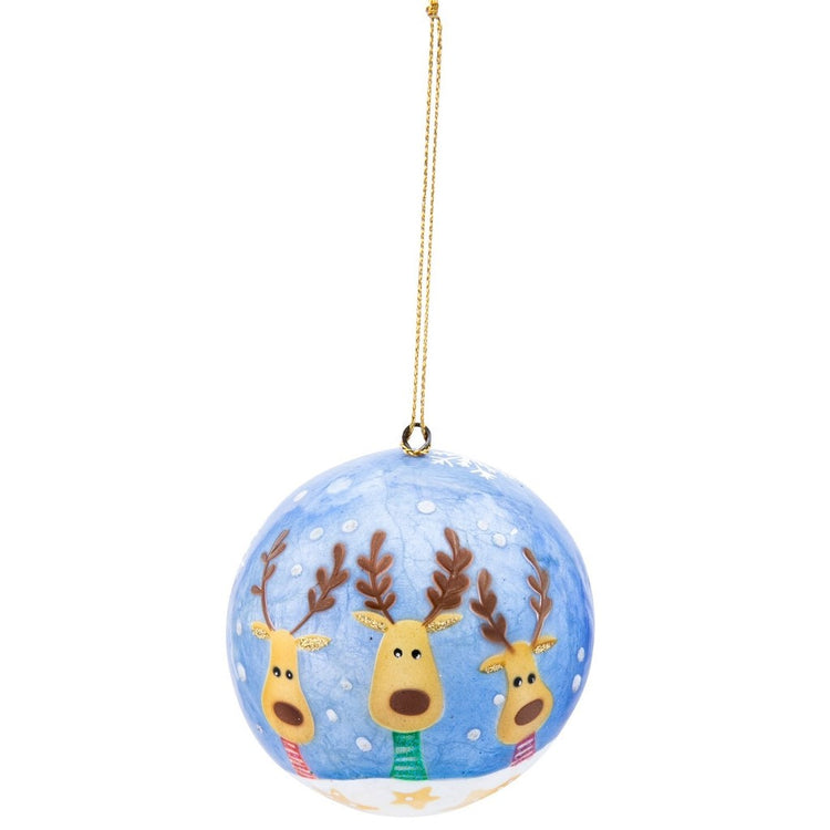 Blue capiz shell ball ornament with three reindeer painted on it.