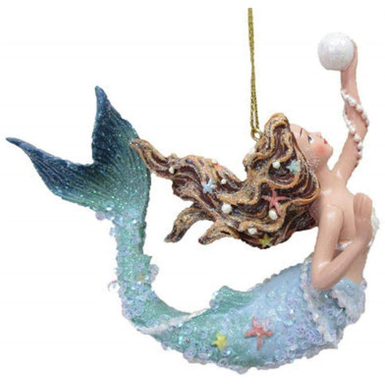 Arched mermaid figurine ornament holding a pearl.  Lots of glitter and bead embellishments.