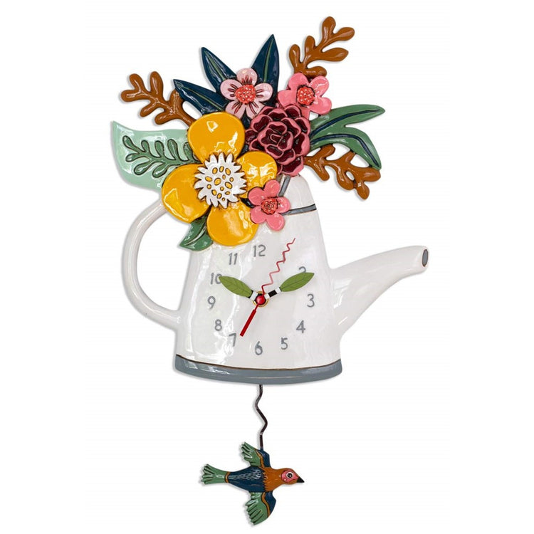 White watering can shaped clock with flowers inside like a vase.  Bird pendulum.