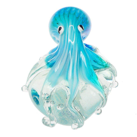 Multiple shades of blue glass octopus on clear ball. Octopus tentacles wrap around the ball.