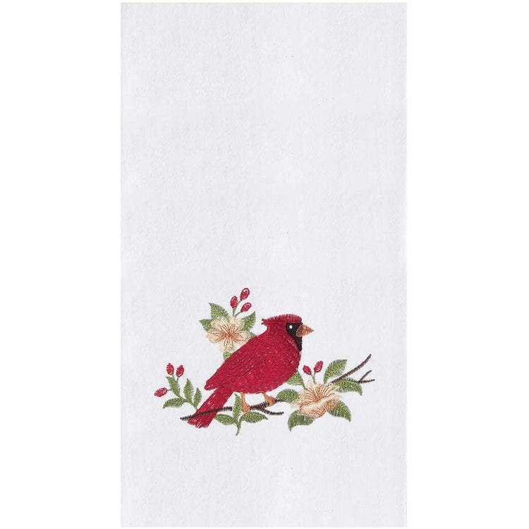 White kitchen towel with red cardinal on holly branches.