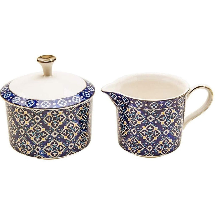 Dark blue diamond pattern cream & sugar set with gold accents and gold trim.