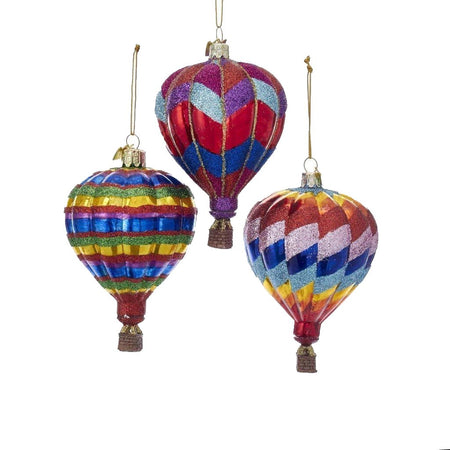3 blown glass hot air balloon ornaments. 1 is rainbow striped. 1 blue, red & purple zig zag. 1 is rainbow zig zag.