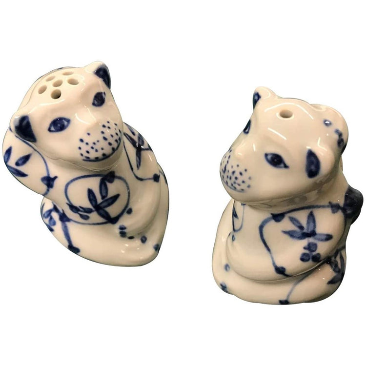 2 white monkey salt and pepper shakers with blue accents.