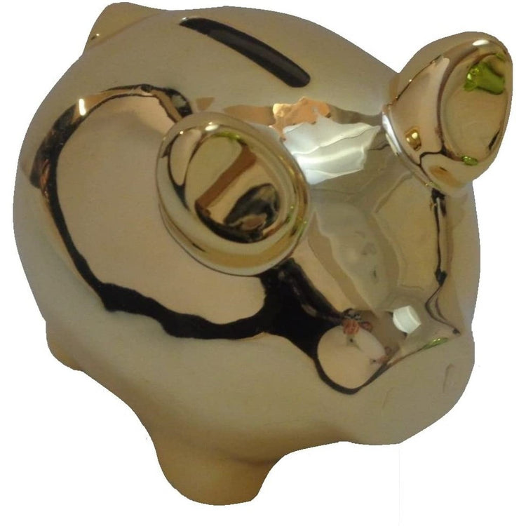 Gold pig shaped bank. entire bank is gold with reflections on surface. Coin slot on back.