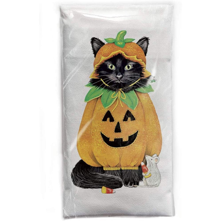 White dishtowel with black cat wearing an orange pumpkin costume including hat.  White mouse looking up holding candy corn.