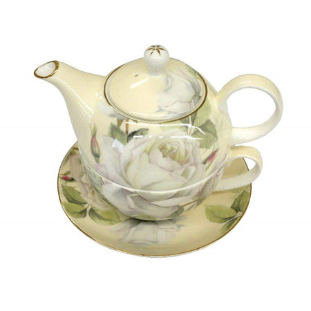 Cream color teapot on cup & saucer. White magnolias & gold trim on all pieces.