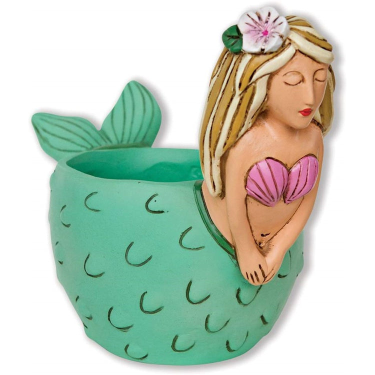Mermaid designed round planter. The tail makes up the planter and is teal. She is blonde with a pink shell bra.