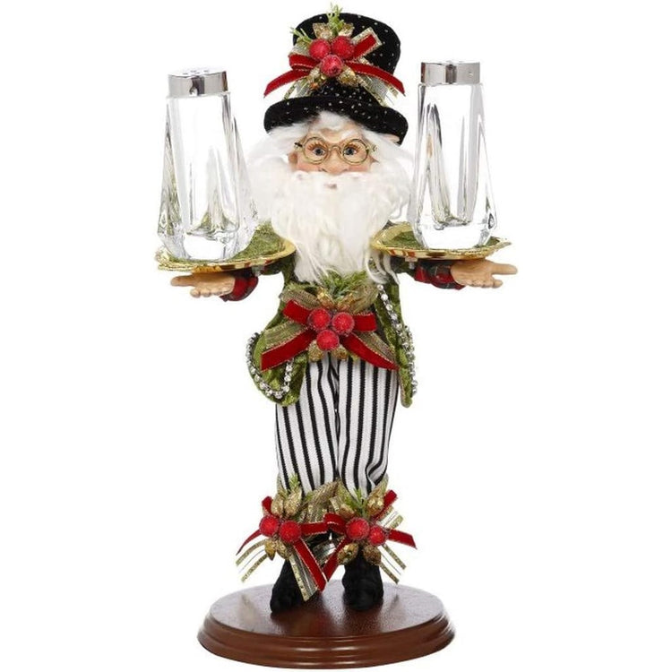 Elf on a stand in striped pants and top hat holding salt and pepper shakers.